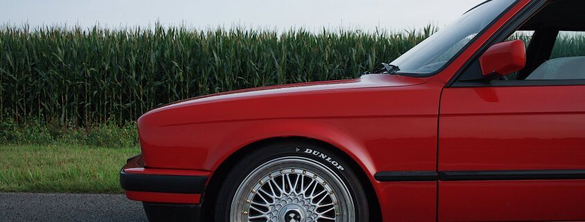 red car tire dunlop tires country road